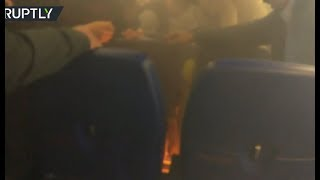 Mobile device catches fire on board A320 passenger plane