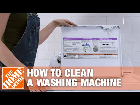 Woman remove clothes from clean washing machine