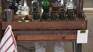 A DIY bar display using a vintage tool box