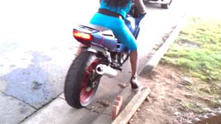 Fine chick ride motorcycle with heels on