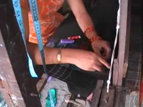 Yashodha Shrestha weaving a design 1