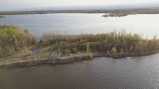 Lake Ontario's record high water erodes the protective sand dune barrier to Sandy Pond