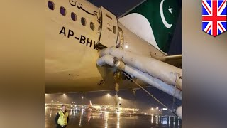 Woman mistakes emergency exit for toilet, delays flight 7 hours- TomoNews