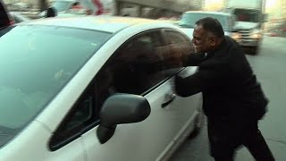 Caught on camera: Taxi driver confronts Uber driver