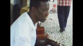 Carioca  man plays  his guitar