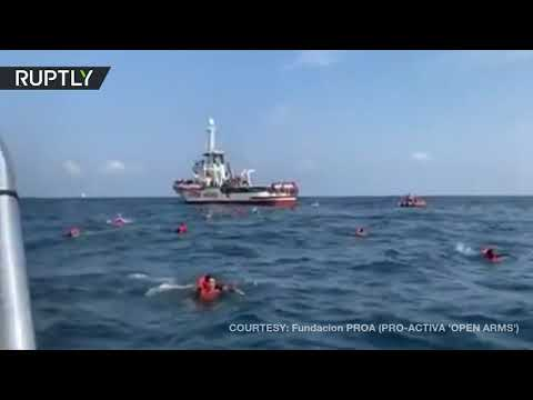 Migrants jump overboard from NGO vessel to swim to Sicily coast