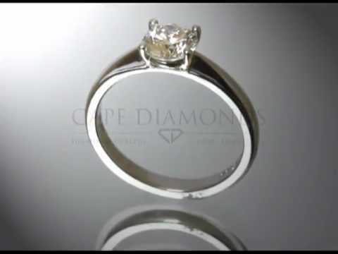 Solitaire ring,round diamond,plain platinum band,engagement ring