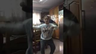 Grandpa dancing behind a girl width=