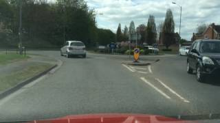 Pulling up on right side of road, reverse 2 car lengths then drive off driving manouevre