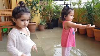 Bella and Vienna's first time seeing rain. :)