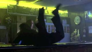 Jackie Chan fights in a bar