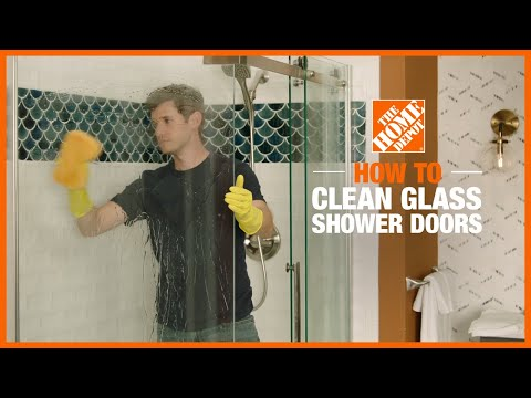 A video outlines method of how to clean glass shower doors.