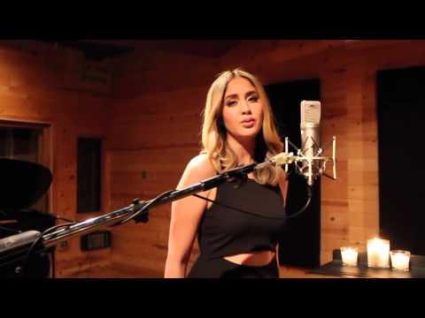 Hello En Espanol de Adele Letra y Video
