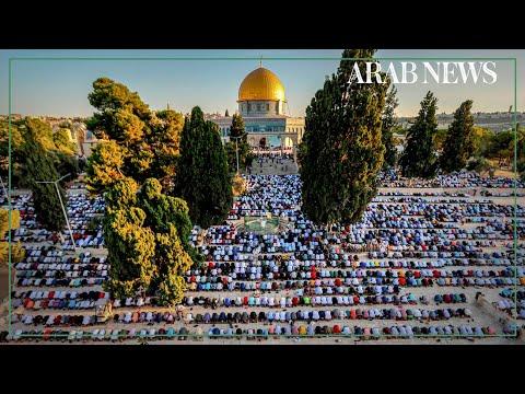 Muslim worshippers take part in Eid Al-Adha prayer in Jerusalem's Al-Aqsa