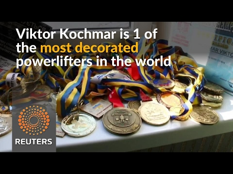 From faith to powerlifting, Ukraine priest inspires