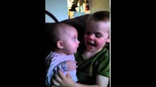 5 month old gets her older brother