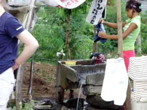 Girl washing clothes in Manchester, Managua, Nicaragua