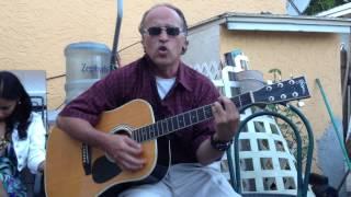 Gilito cantando con la guitarra 1
