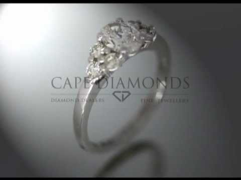 Complex stone ring,oval dimaond,3 diamonds each side,platinum,engagement ring