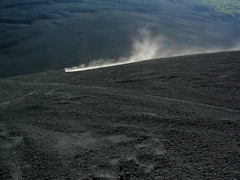 Racing down Cerro Negro – Erin in orange, Elliot in blue.