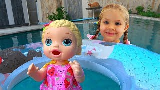 Diana and her super fun day with Baby Doll