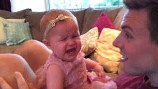 Baby reacts to daddy shaving his beard
