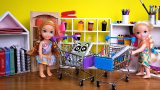 Elsa and Anna toddlers buy school supplies from store - Barbie is seller