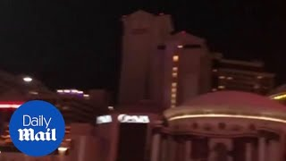Las Vegas dims iconic strip lights in remembrance of mass shooting