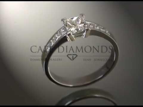 Princess cut,diamond,4 side stones each side,platinum,engagement ring