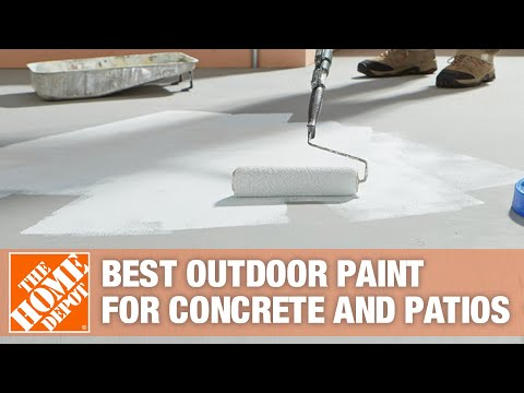 Woman painting concrete floor with paint roller