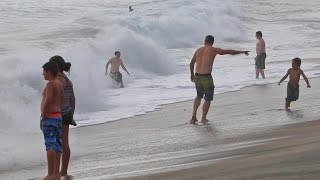Ocean Waves at high tide catches some off guard