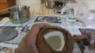 How to cut open a Brown Coconut without losing any of the water (a demo by a Master Coconut Man).