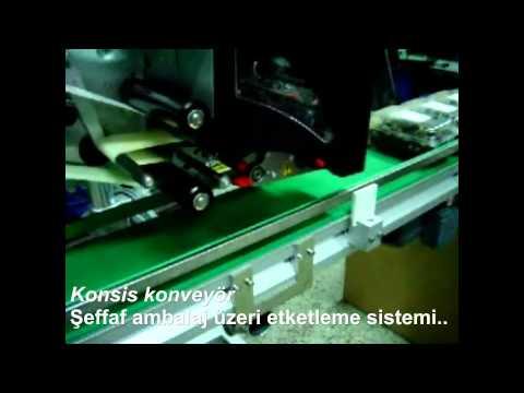 Konsis konveyör şeffaf ambalaj üzeri seri etiketleme konveyör sistemi..