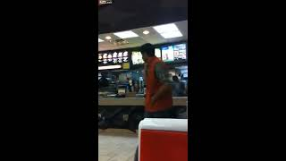 Girl jumps counter at McDonalds to go fight dude then he beats her ass with a metal stick