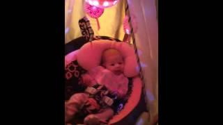 Tasha Luna in Fisher Price cradle swing