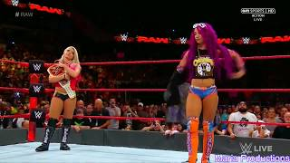 Sasha Banks enters the arena with Batista's theme song