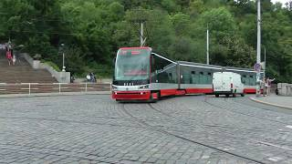 trams and tram tracks on Cechuv Most (Cech Bridge), Prague, Czech Republic