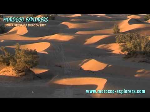 Morocco saharan dunes at sunset – A Desert Village in the Sahara