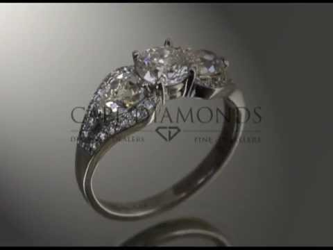 Complex stone ring,round diamond,2 pear shaped diamonds,side stones,platinum,engagement ring