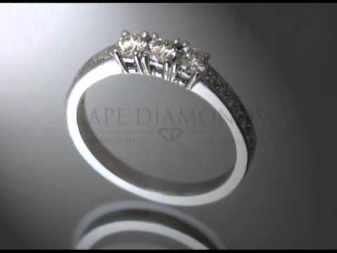 3 stone ring,round diamonds,round diamonds on side,baroque detail,platinum,engagement ring