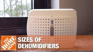 A 70-pint dehumidifier sits near the corner of a living room.