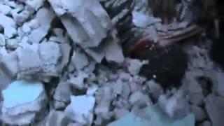 (01-24-2012) Karm Al Zaitoun | Homs | Pulling dead bodies stuck under debris
