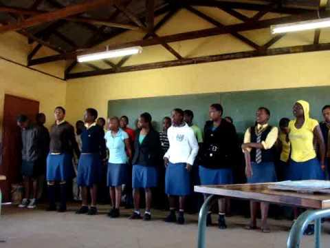 School children singing and dancing