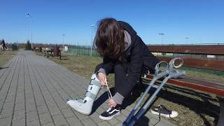 Monica Aircast with crutches in the city 4K