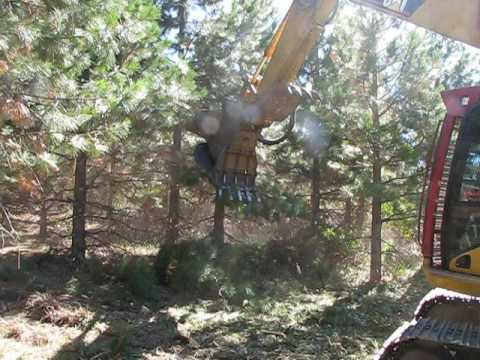 Mulching with a RDM Series mulcher on this CAT 315D excavator.