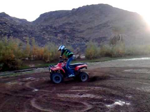 ATV motorcycle spin in Fint river Oasis Ouarzazate Morocco