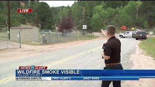 Crews battle wildfire along Rampart Range Road