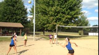 Beach volleyball angling the bump set and using the jump poke shot