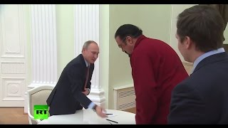 Sign Here: Putin presents Steven Seagal with his new Russian passport