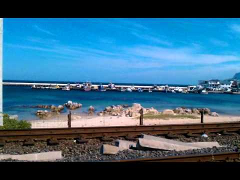 Train rolling past Cape to Cuba, Kalk Bay, Western Cape, South Africa